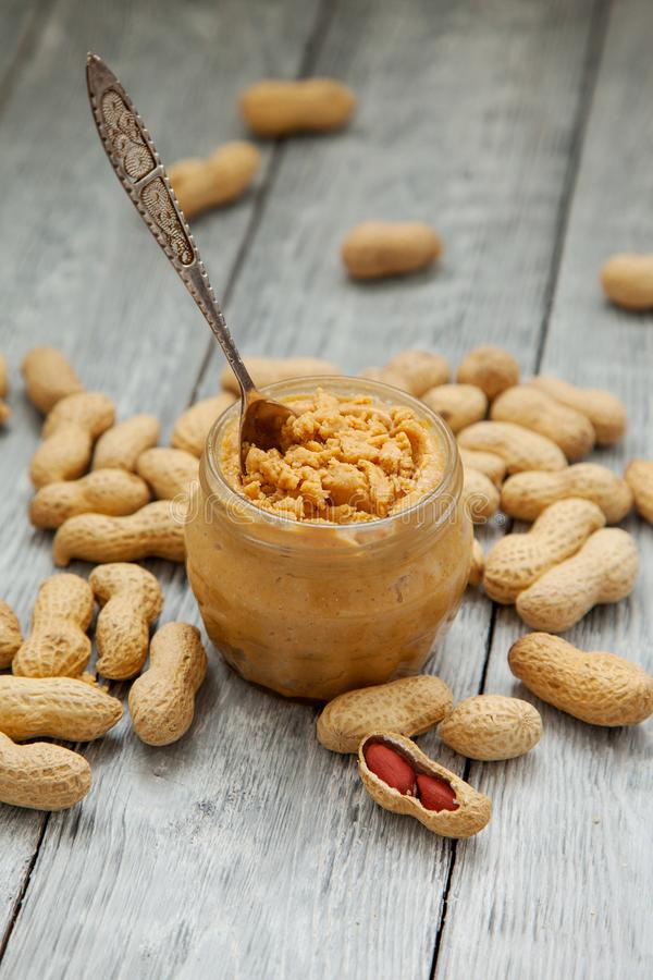 An open jar of peanut butter with spoon royalty free stock image