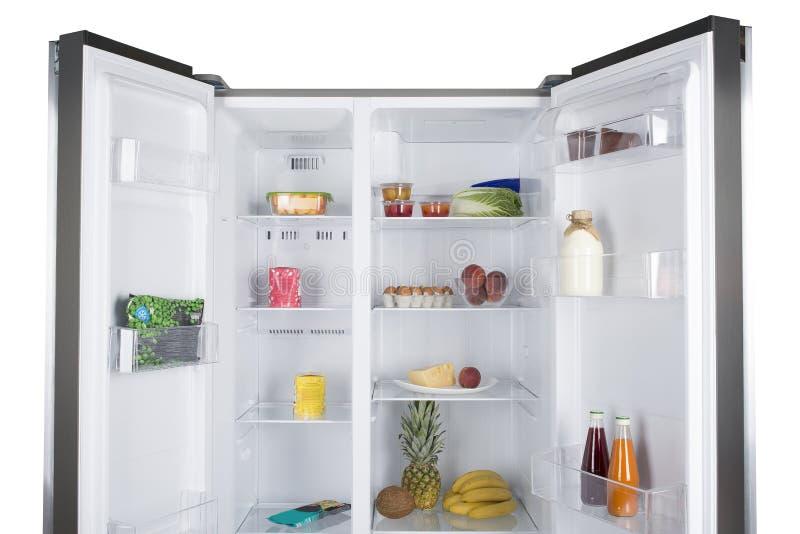 Open koelkasthoogtepunt van verse vruchten en groenten stock afbeeldingen
