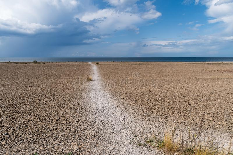 Open landscape with pebbles by the coast stock photos