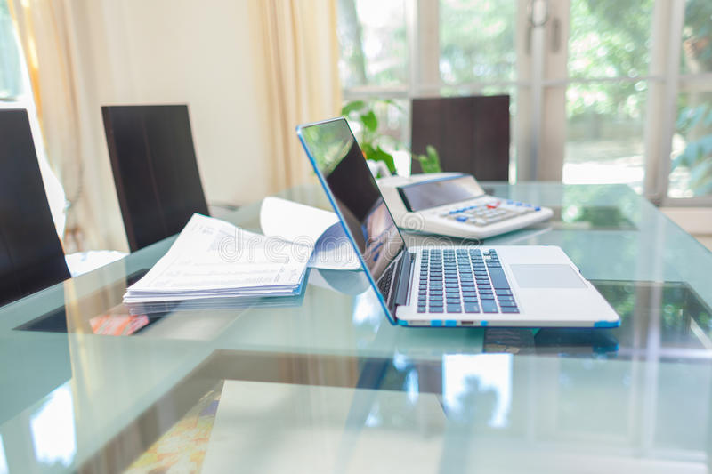 Open laptop and accessories for home workplace. Business and technology concepts royalty free stock image
