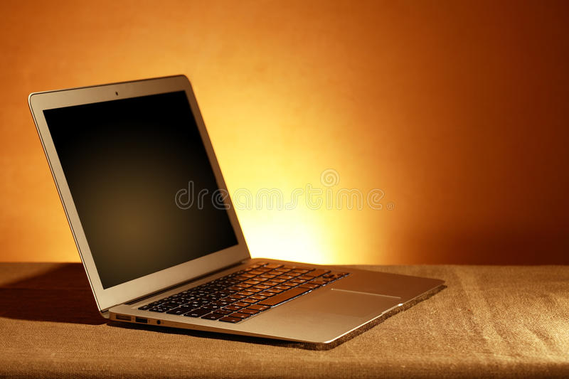 Open Laptop. With blank screen against nice yellow background stock photos