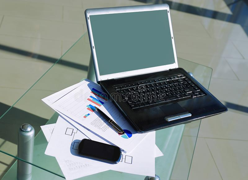 Open laptop and mobile phone on the office desktop.  royalty free stock photo