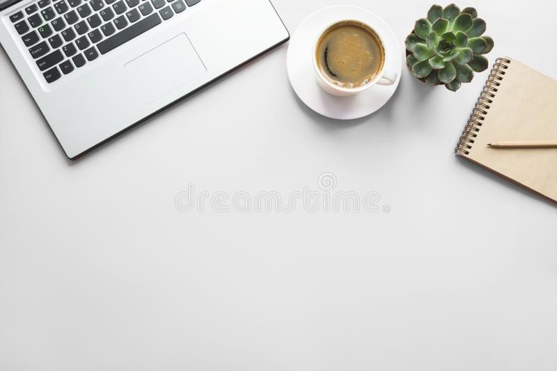 Open laptop, planning and cup of coffee. Top view with copy space. Office business concept. Working process. Workspace with open laptop, documentation, and cup royalty free stock images