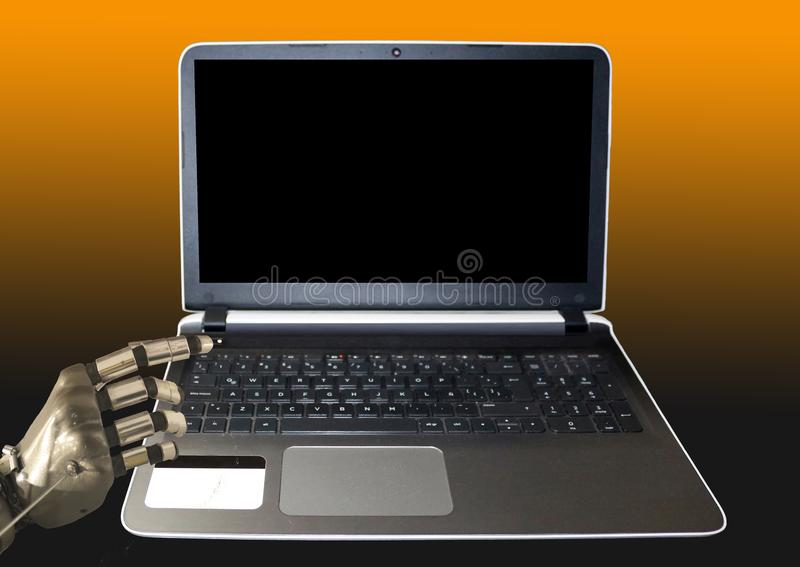 Open laptop ready to be turned on by a robotic hand royalty free stock photo
