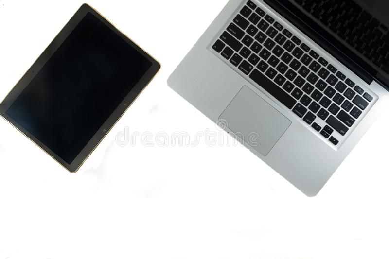 Open laptop and tablet isolated on white background stock photo