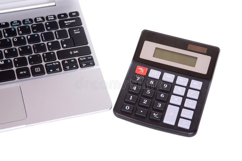 Open laptop toetsenbord en calculator royalty-vrije stock foto