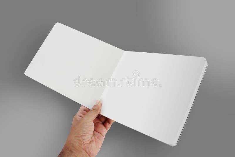 Open Leeg Boek/Brochuremodel in een Hand royalty-vrije stock afbeeldingen