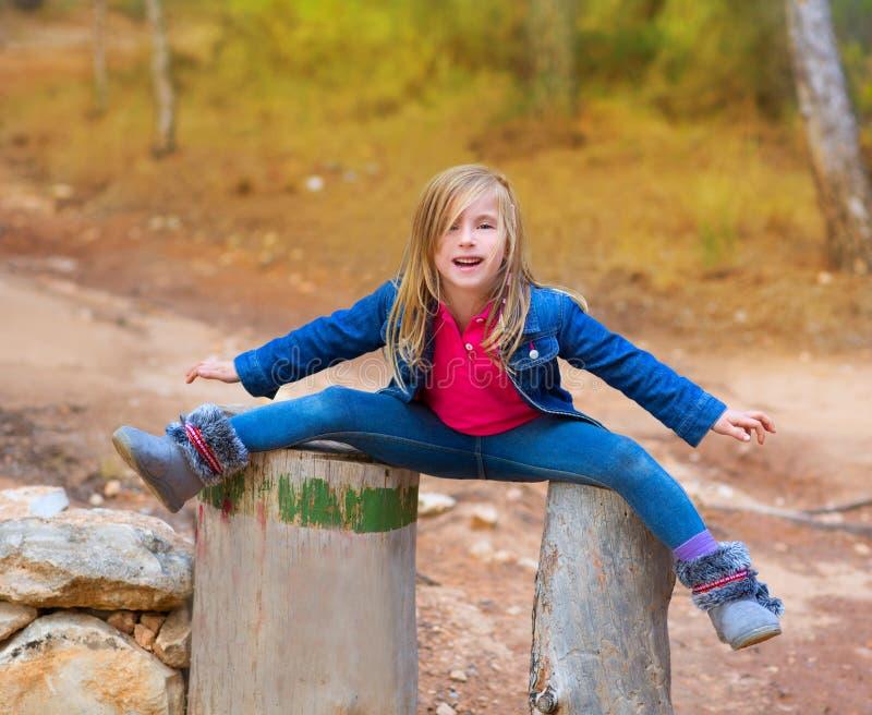 Open legs children girl or tree trunks at forest stock images