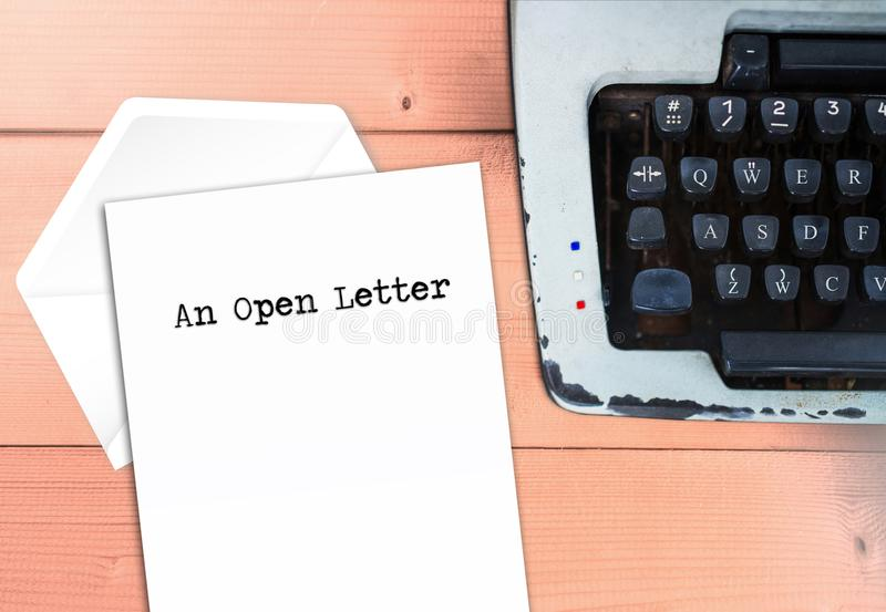 An open letter with envelop. And typewriter on vintage wood desk, office and situation concept royalty free stock image