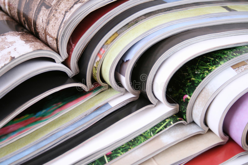 Open magazines. Stack of open magazines - close-ups royalty free stock photo