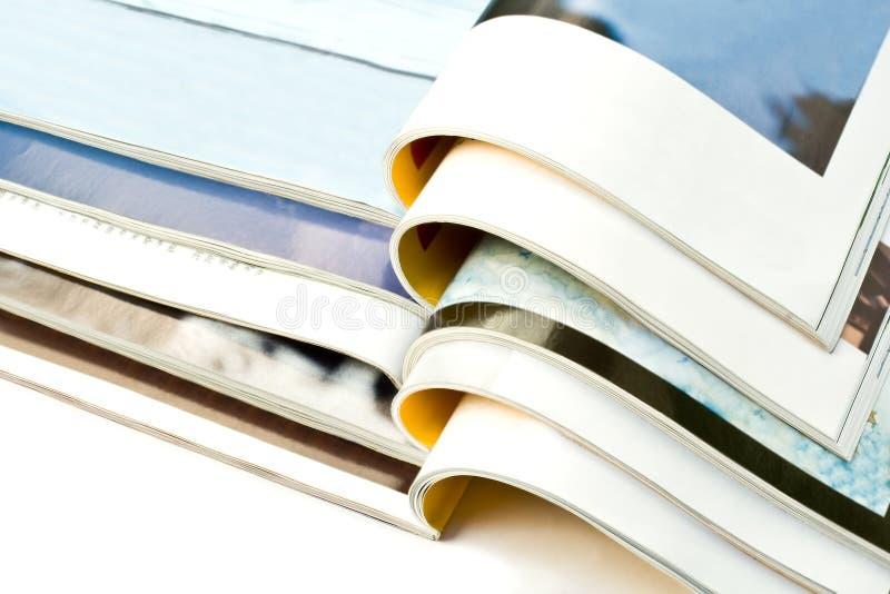Open magazines isolated on white background stock image