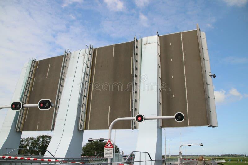 Open Maximabrug bridge over the Oude Rijn River in Alphen aan den Rijn in the Netherlands. stock photos