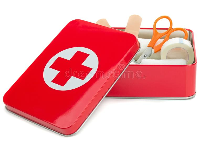 An open metal first aid box with contents. NIEDERSACHSEN, GERMANY AUGUST 10, 2014 - An open metal first aid box with contents on a white background stock photography