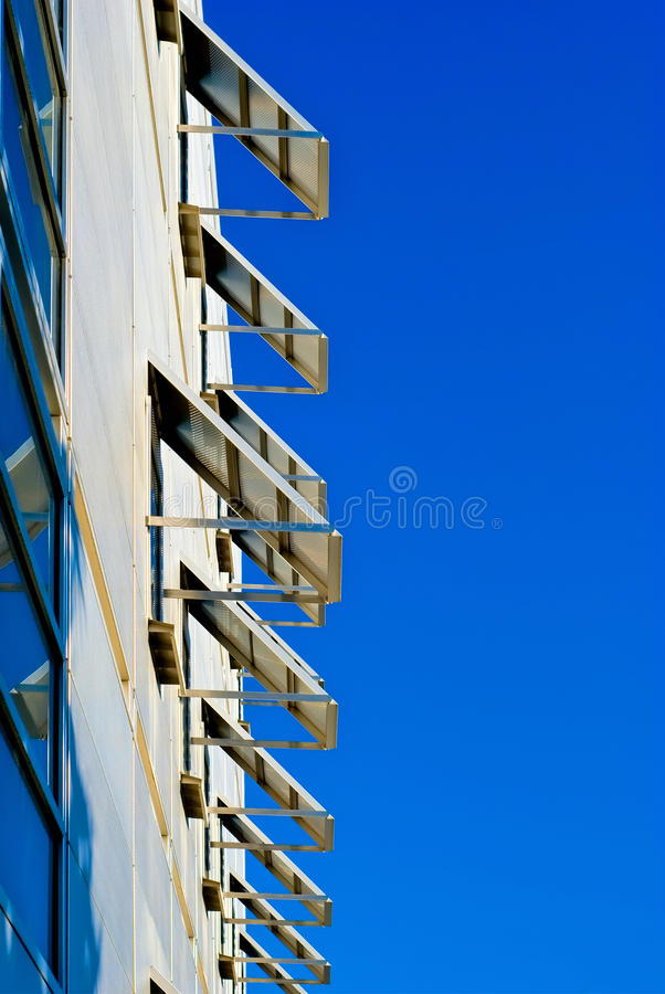 Open metalic windows on blue sky royalty free stock images