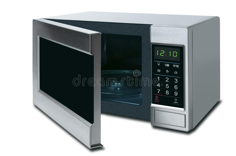 Open microwave oven isolated on a white background stock image