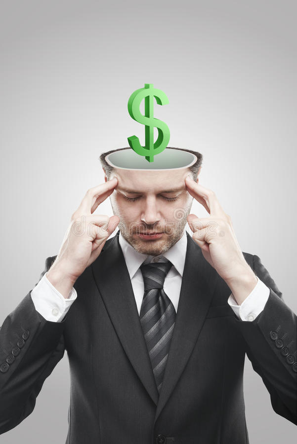 Open minded man with 3d Green Dollar Sign inside. Thinking about it. Conceptual image of a open minded man royalty free stock photography