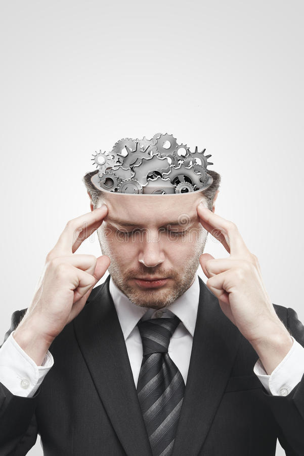 Open minded man with gears and cogs inside. Showing brain activity. Conceptual image of a open minded man stock images