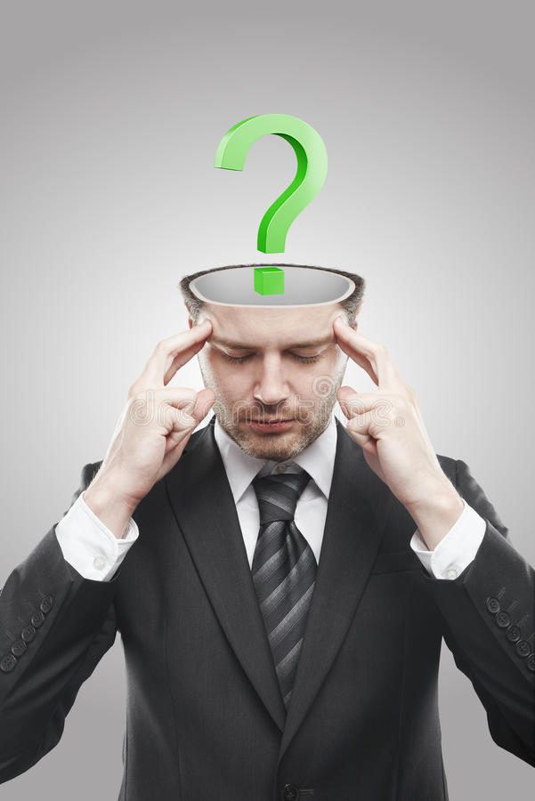 Open minded man with Green question mark inside stock photography