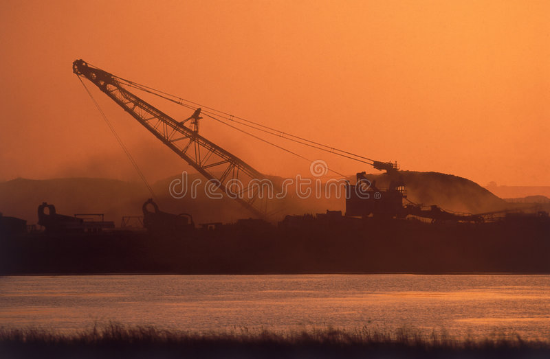 Open mine. Operating while the sunsets royalty free stock image