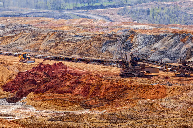 Open mining pit. With heavy machinery stock photo