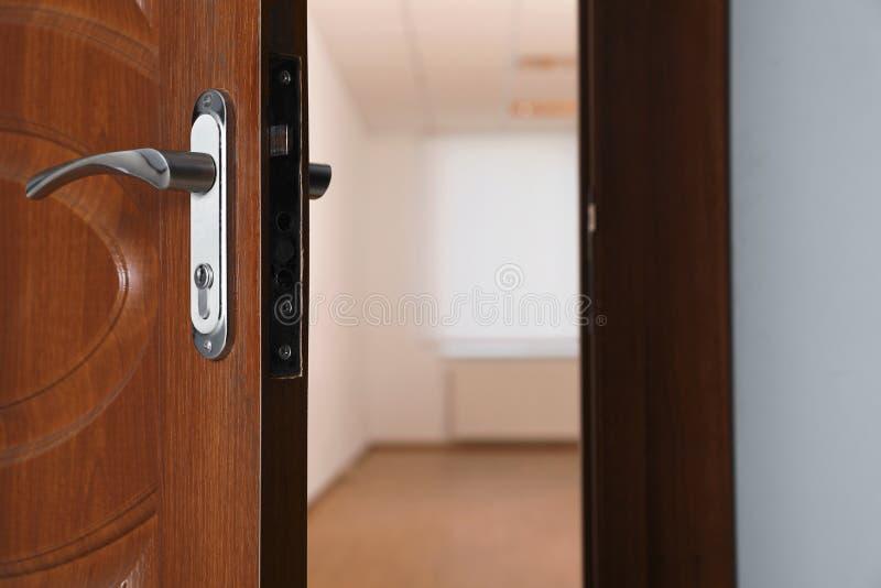 Open modern door to empty light room royalty free stock photo