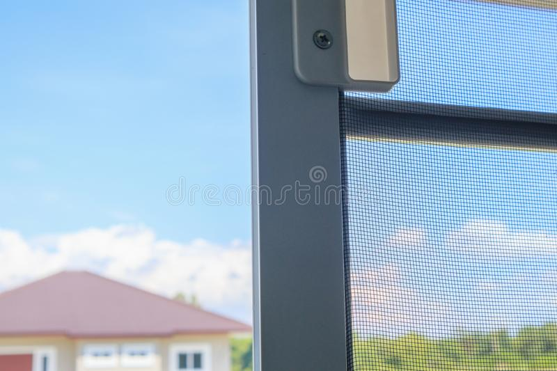 Open mosquito net wire screen on house window protection against insect. Close up stock image