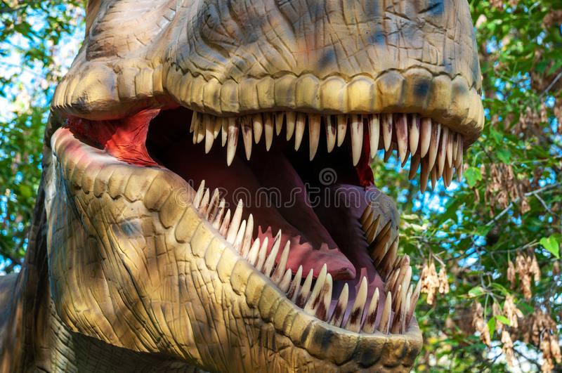 The open mouth of a tyrannosaur with huge sharp teeth. Part closeup royalty free stock image