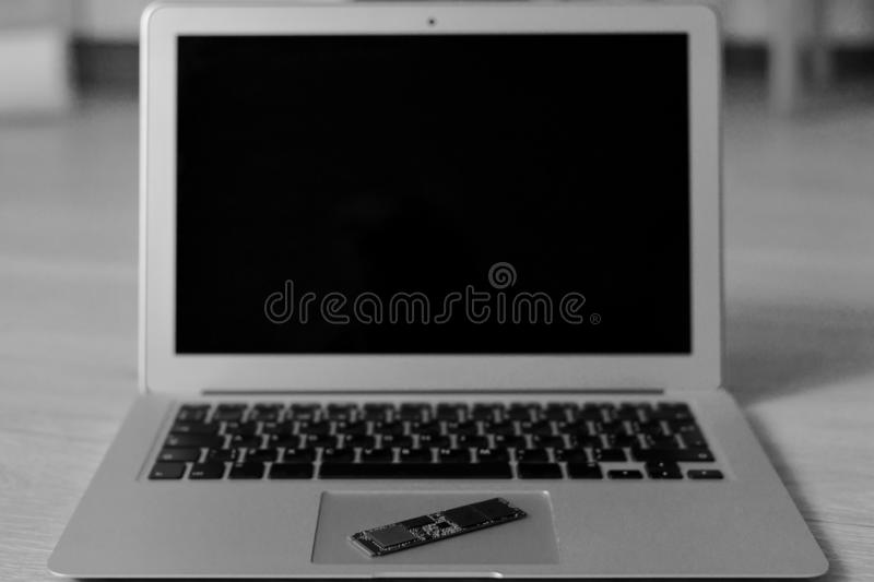 An open netbook on a wooden surface. royalty free stock image
