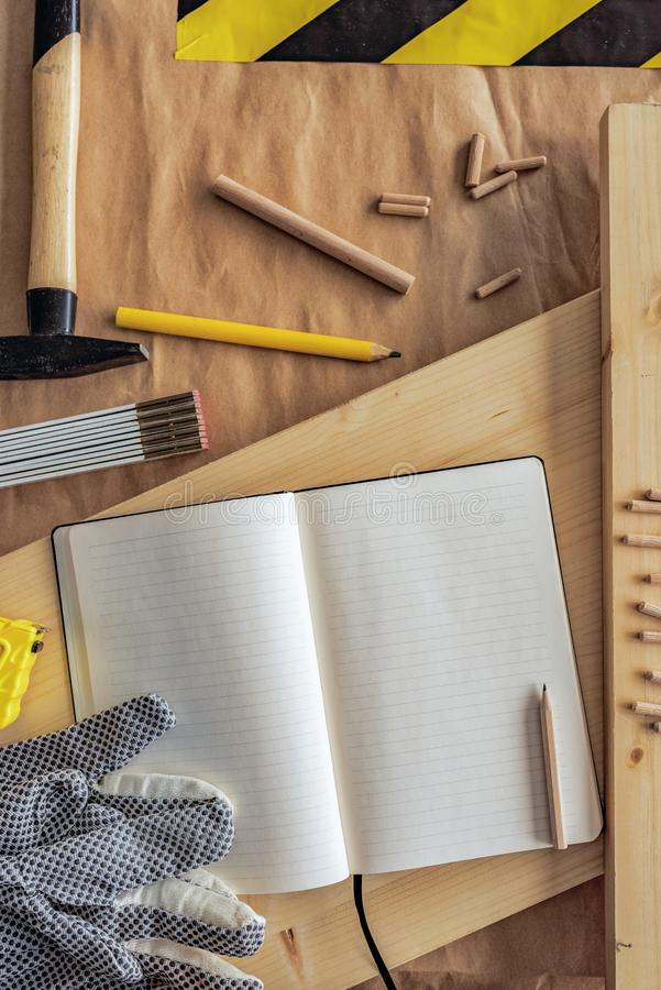 Open note book with blank pages in carpentry workshop stock images