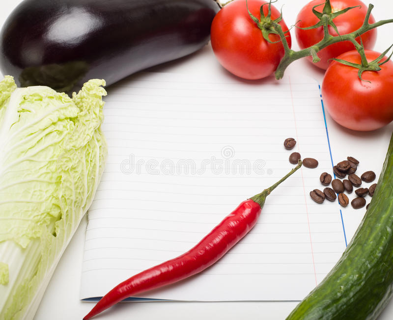Open note book vegetables for writing recipe