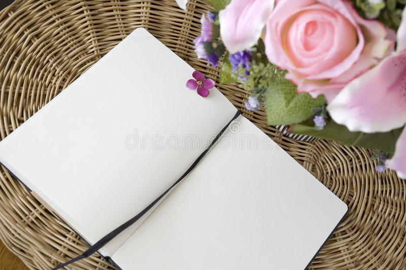 Download Open notebook on basket stock photo. Image of floral - 30702554