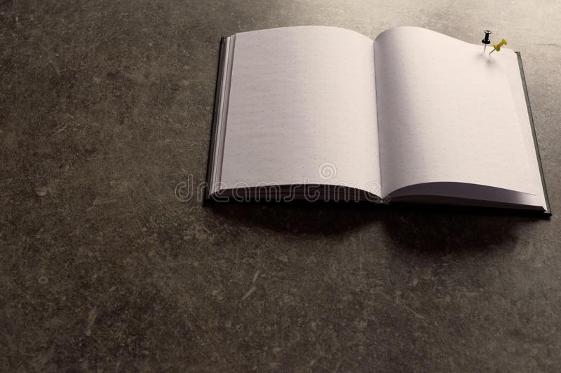 Open notebook with blank pages on brown grey grunge background stock image