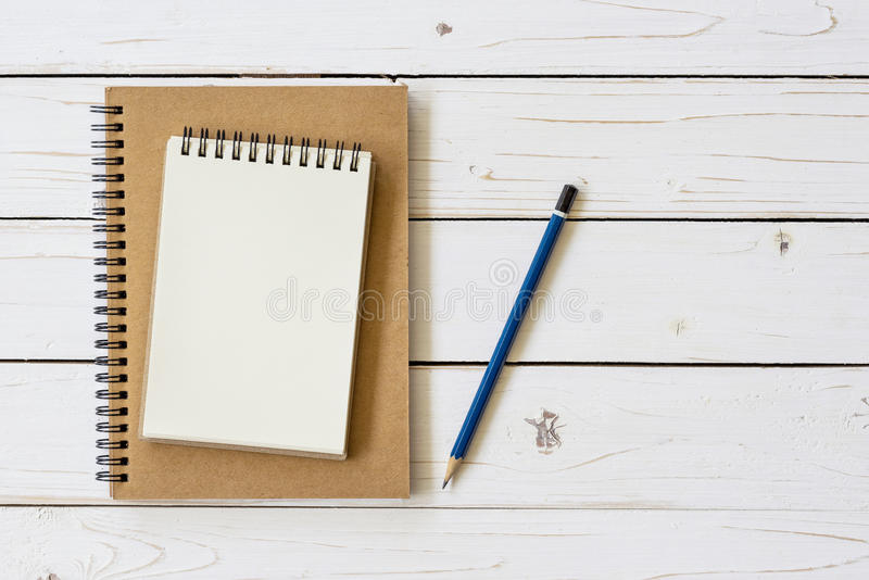 Open notebook with blank pages and pencil royalty free stock image
