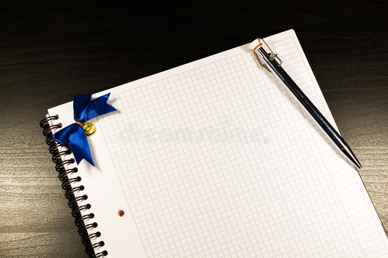 Open notebook with blank pages and pencil on black wooden background royalty free stock photos