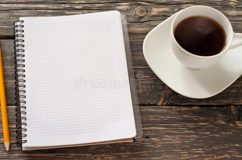 Open notebook with blank pages, pencil and cup tea royalty free stock images