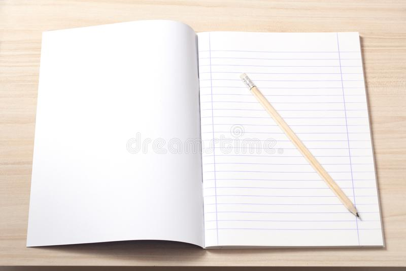 Notebook and a Pencil on a Desk royalty free stock photo