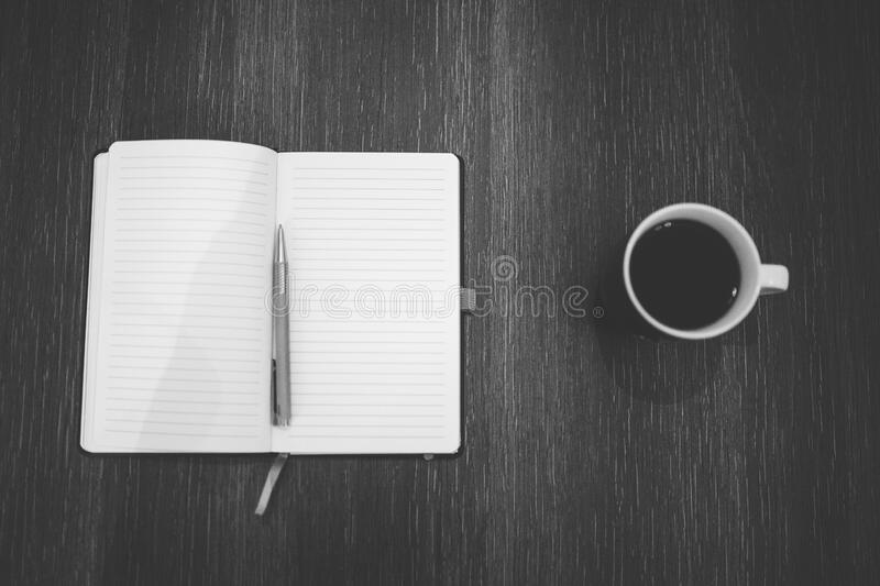 Open notebook and cup of coffee royalty free stock photos