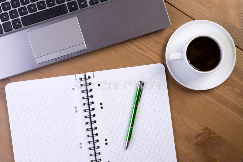 Open notebook on desk. With coffee and laptop stock photography