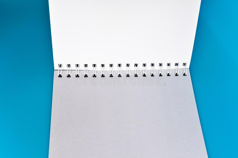 An open notebook. Isolated on a blue background stock photo