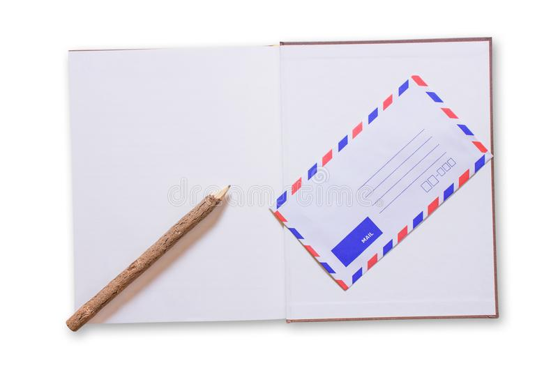 Open notebook and mail on white background. stock photography