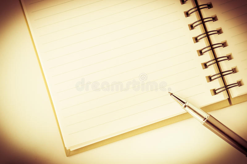 Open notebook with metallic ball pen royalty free stock photo