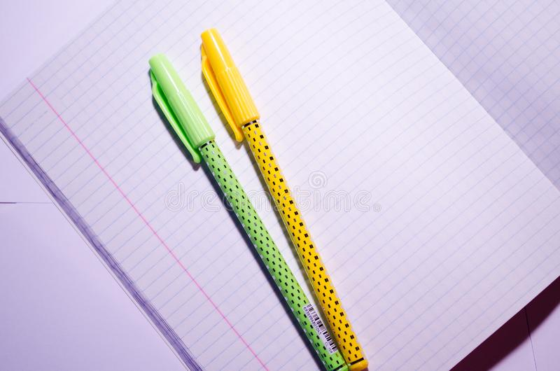 Open notebook. Open notebook with pens. Open squared notebook with school supplies. Office Chancellery. Clean copybook. School royalty free stock photo