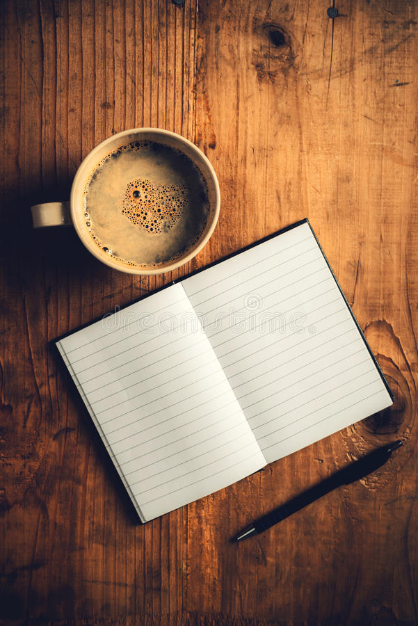 Open notebook, pencil and cup of coffee royalty free stock image