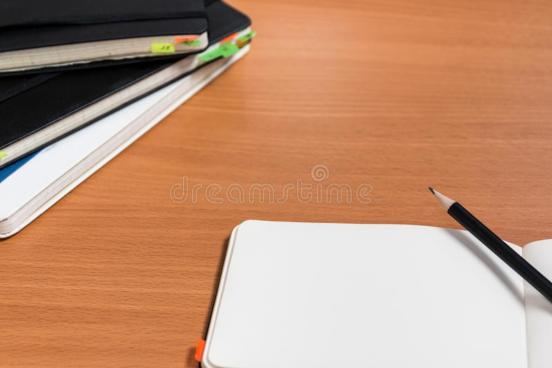 Open notebook with pencil stock photos