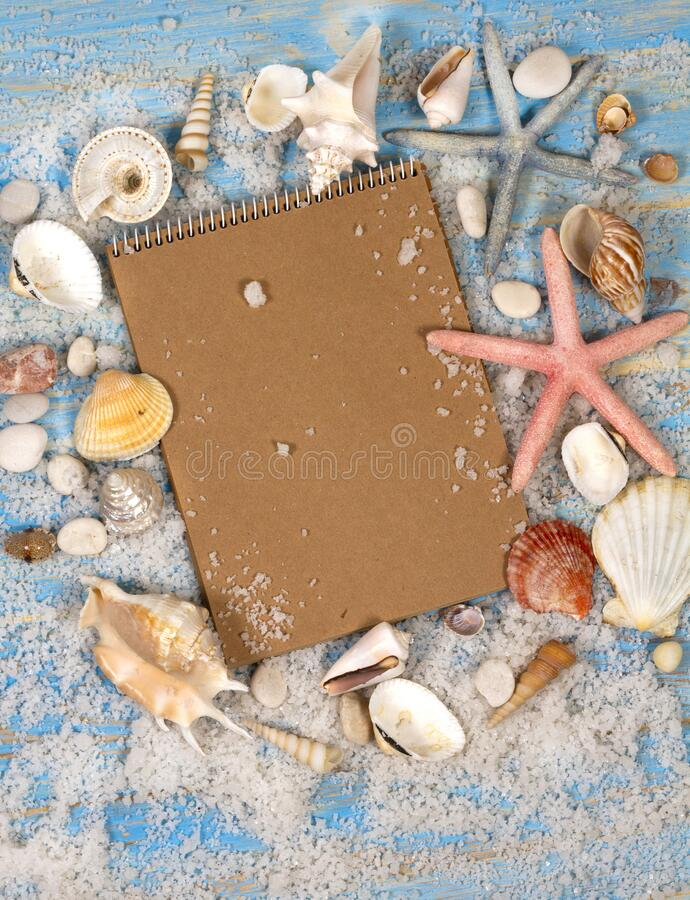 Open notebook with seashells and starfish. Planning summer holidays, travel and vacation background. stock image