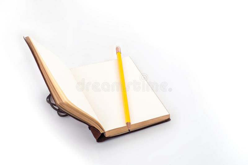 Open notebook on white background with yellow pencil stock photos