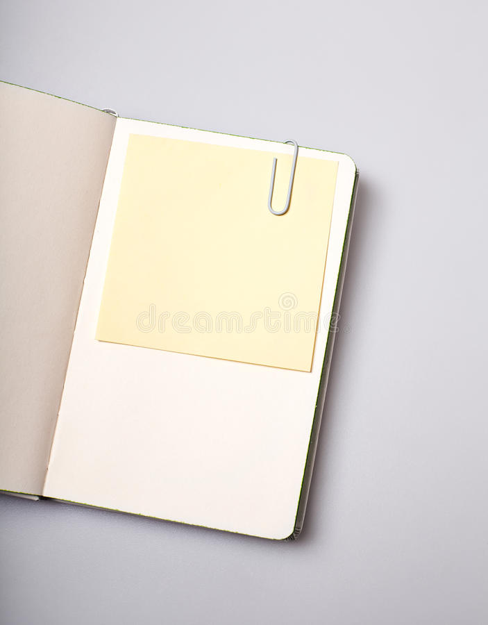 Open notepad blank page with note sticker on white table stock photography