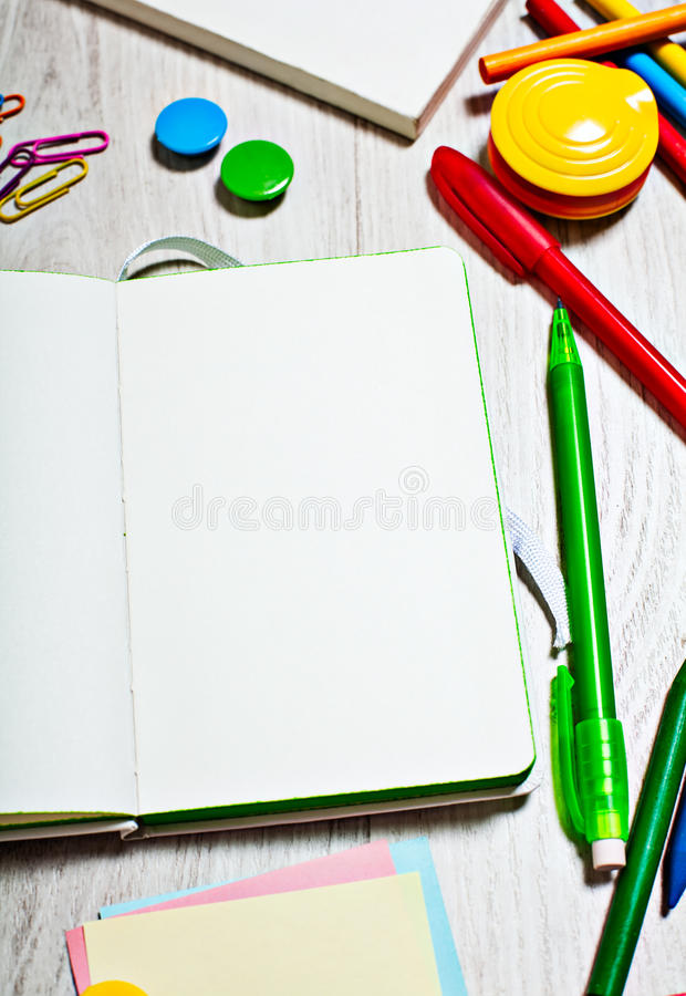 Open notepad with blank pages on table with office tools. Open paper notepad with blank pages on table with office tools stock photos