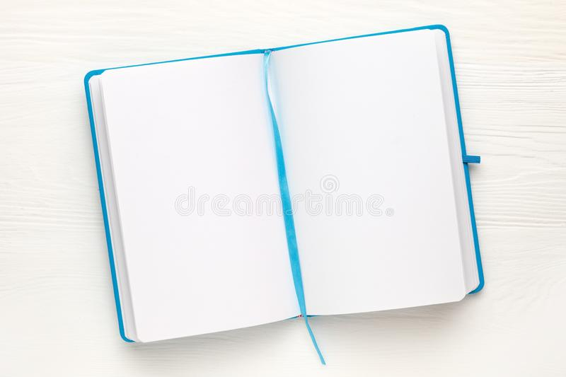 Open Notepad with clean sheets on white background royalty free stock image
