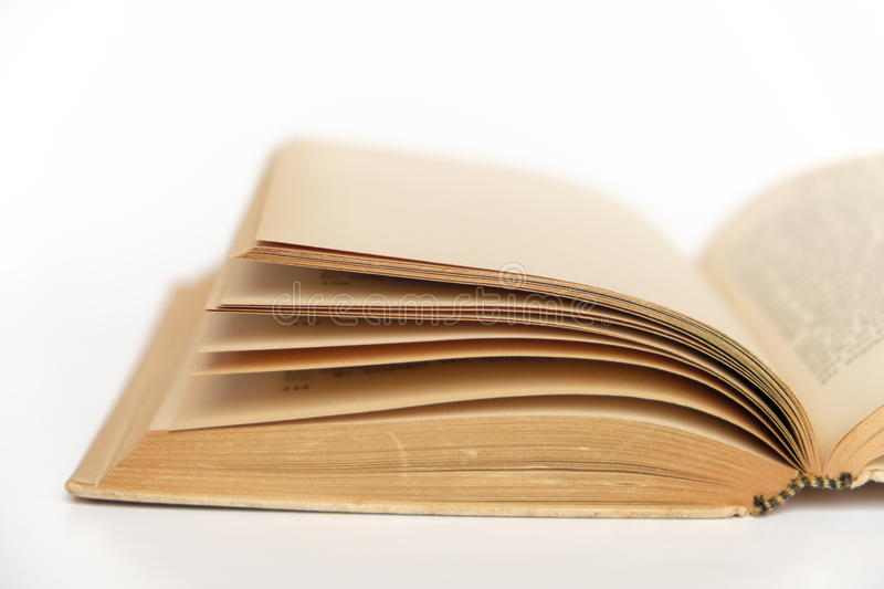 Open old book closeup on white background royalty free stock photo